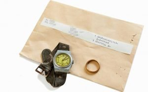 ITS seeks to return Holocaust victim Istvan Zusz's watch and wedding ring to his family through its #StolenMemory campaign. (Cornelis Gollhardt/ITS)